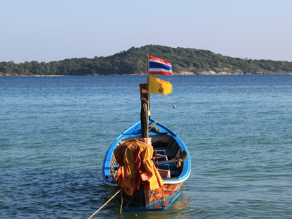 Thai longboat with flags