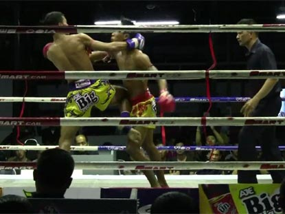 Muay Thai match at Lumpini Stadium in Bangkok city