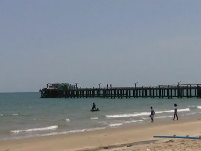 Coastal scene in Rayong with pier in background