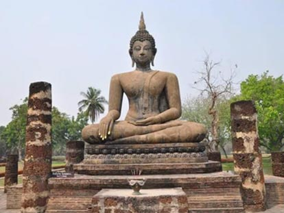 Stone Buddha statue sitting with legs crossed